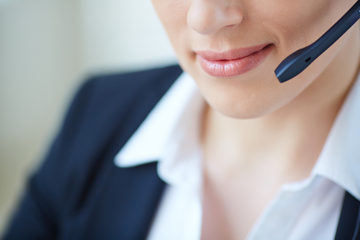 Part of face of young customer support representative